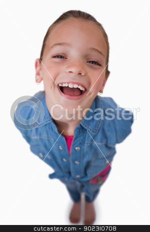Portrait of a cheerful girl smiling at the camera stock photo, Portrait of a cheerful girl smiling at the camera against a white background by Wavebreak Media