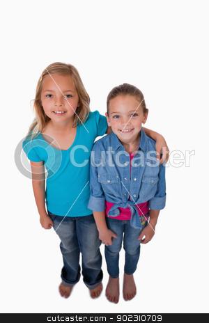 Portrait of girls posing stock photo, Portrait of girls posing against a white background by Wavebreak Media