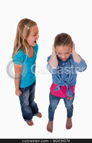 Portrait of a girl screaming at her friend stock photo, Portrait of a girl screaming at her friend against a white background by Wavebreak Media