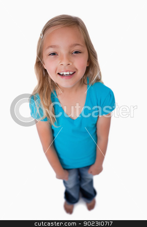 Portrait of a cute girl smiling at the camera stock photo, Portrait of a cute girl smiling at the camera against a white background by Wavebreak Media