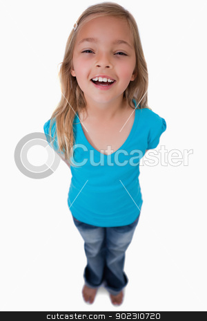 Portrait of a cheerful girl posing stock photo, Portrait of a cheerful girl posing against a white background by Wavebreak Media