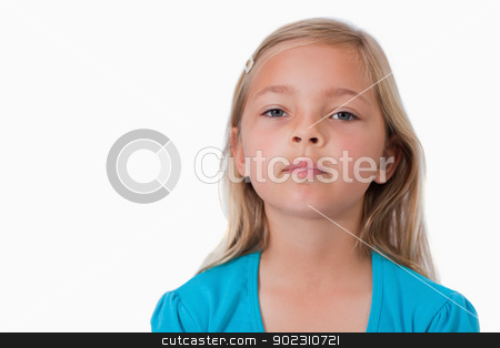 Serious girl posing stock photo, Serious girl posing against a white background by Wavebreak Media
