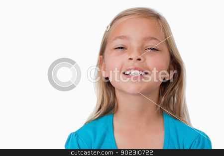 Smiling girl posing stock photo, Smiling girl posing against a white background by Wavebreak Media