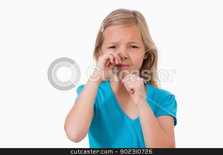 Lonely little girl crying stock photo, Lonely little girl crying against a white background by Wavebreak Media