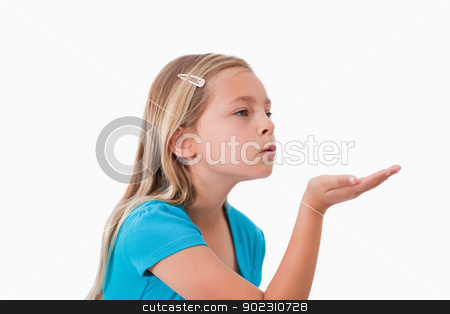 Girl blowing a kiss stock photo, Girl blowing a kiss against a white background by Wavebreak Media