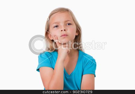 Little girl thinking stock photo, Little girl thinking against a white background by Wavebreak Media
