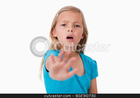 Unhappy girl saying stop with her hand stock photo, Unhappy girl saying stop with her hand against a white background by Wavebreak Media
