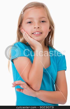 Portrait of a cute girl posing stock photo, Portrait of a cute girl posing against a white background by Wavebreak Media