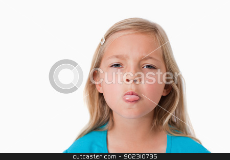 Girl sticking out her tongue stock photo, Girl sticking out her tongue against a white background by Wavebreak Media
