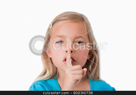 Young girl asking for silence stock photo, Young girl asking for silence against a white background by Wavebreak Media