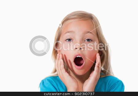 Young girl being scared stock photo, Young girl being scared against a white background by Wavebreak Media