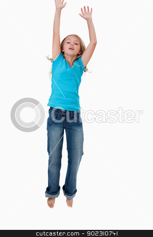 Portrait of a girl jumping stock photo, Portrait of a girl jumping against a white background by Wavebreak Media