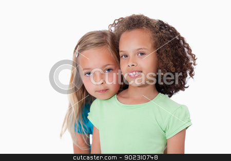 Cute girls posing stock photo, Cute girls posing against a white background by Wavebreak Media