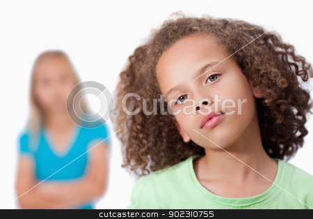 Girl posing with her friend in the background stock photo, Girl posing with her friend in the background against a white background by Wavebreak Media
