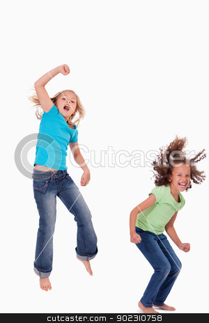 Portrait of girls jumping stock photo, Portrait of girls jumping against a white background by Wavebreak Media