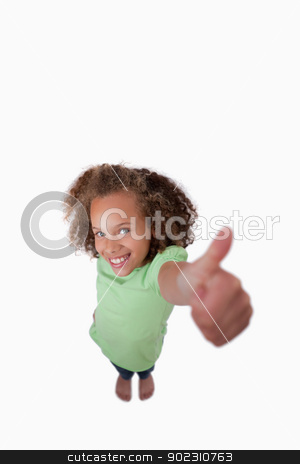 Portrait of a happy girl with the thumb up stock photo, Portrait of a happy girl with the thumb up against a white background by Wavebreak Media