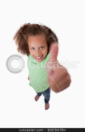 Portrait of a smiling girl with the thumb up stock photo, Portrait of a smiling girl with the thumb up against a white background by Wavebreak Media