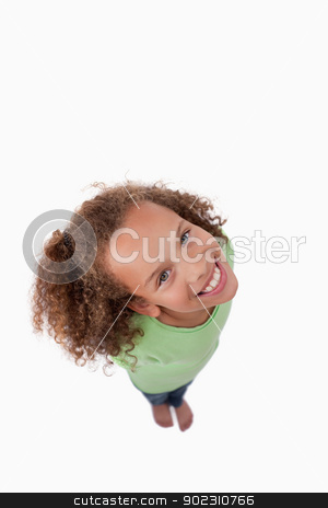 Portrait of a girl smiling at the camera above her stock photo, Portrait of a girl smiling at the camera above her against a white background by Wavebreak Media