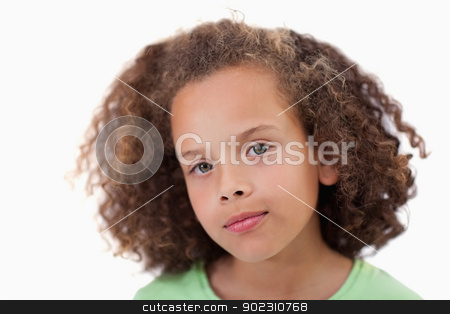 Close up of a girl looking at the camera stock photo, Close up of a girl looking at the camera against a white background by Wavebreak Media