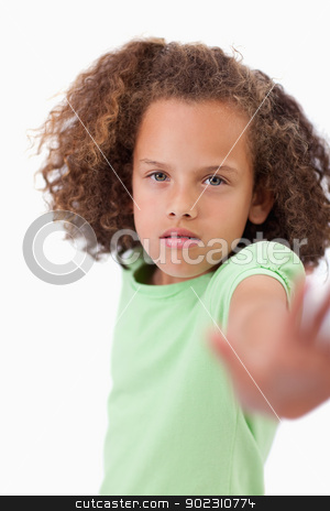 Portrait of a girl saying stop with her hand stock photo, Portrait of a girl saying stop with her hand against white background by Wavebreak Media