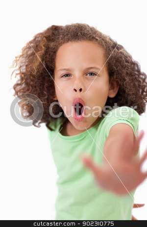 Portrait of an unhappy girl saying stop with her hand stock photo, Portrait of an unhappy girl saying stop with her hand against a white background by Wavebreak Media