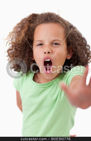 Portrait of an angry girl saying stop with her hand stock photo, Portrait of an angry girl saying stop with her hand against a white background by Wavebreak Media