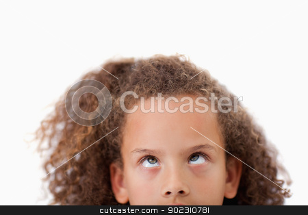 Close up of a playful girl looking above her stock photo, Close up of a playful girl looking above her against a white background by Wavebreak Media