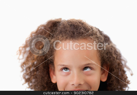 Close up of a playful girl looking up stock photo, Close up of a playful girl looking up against a white background by Wavebreak Media