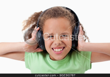 Cute girl listening to music stock photo, Cute girl listening to music against a white background by Wavebreak Media