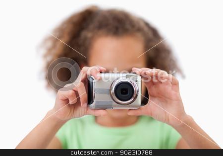 Little girl taking a picture stock photo, Little girl taking a picture against a white background by Wavebreak Media