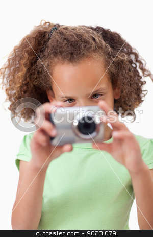 Portrait of a girl taking a picture stock photo, Portrait of a girl taking a picture against a white background by Wavebreak Media