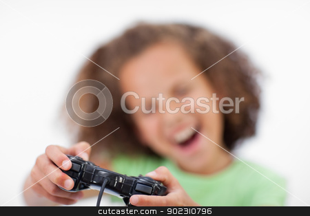 Smiling girl playing a video game stock photo, Smiling girl playing a video game against a white background by Wavebreak Media