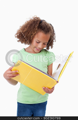 Portrait of a girl reading a fairy tale stock photo, Portrait of a girl reading a fairy tale against a white background by Wavebreak Media