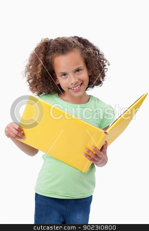 Portrait of a smiling girl reading a fairy tale stock photo, Portrait of a smiling girl reading a fairy tale against a white background by Wavebreak Media