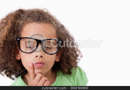 Smart girl thinking stock photo, Smart girl thinking against a white background by Wavebreak Media