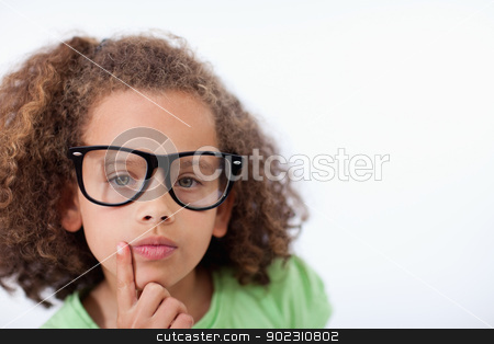 Young girl thinking stock photo, Young girl thinking against a white background by Wavebreak Media
