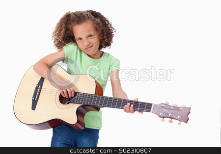 Girl playing the guitar stock photo, Girl playing the guitar against a white background by Wavebreak Media