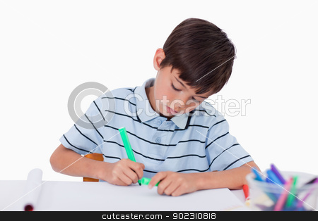 Young boy drawing stock photo, Young boy drawing against a white background by Wavebreak Media