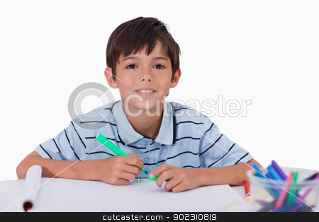 Happy boy drawing stock photo, Happy boy drawing against a white background by Wavebreak Media