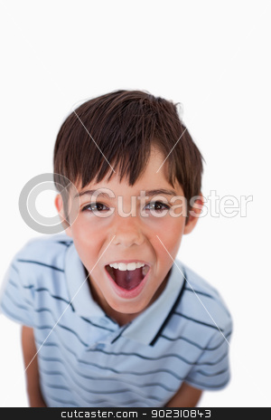 Portrait of a boy screaming at the viewer stock photo, Portrait of a boy screaming at the viewer against a white background by Wavebreak Media