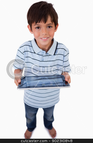Portrait of a happy boy using a tablet computer stock photo, Portrait of a happy boy using a tablet computer against a white background by Wavebreak Media