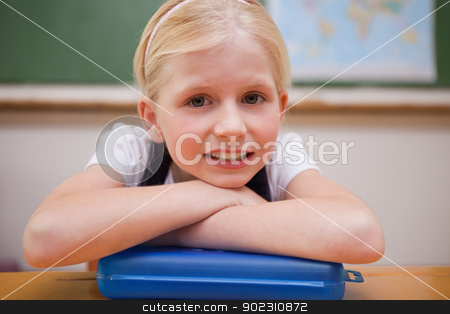 Girl leaning on her desk stock photo, Girl leaning on her desk in a classroom by Wavebreak Media