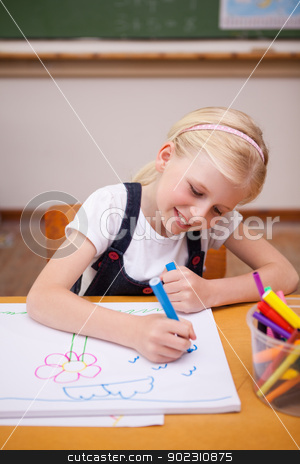 Portrait of a girl drawing stock photo, Portrait of a girl drawing in a classroom by Wavebreak Media
