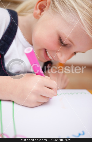 Portrait of a delighted girl drawing stock photo, Portrait of a delighted girl drawing in a classroom by Wavebreak Media