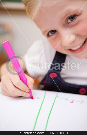 Portrait of a cute girl drawing stock photo, Portrait of a cute girl drawing in a classroom by Wavebreak Media