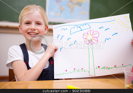 Girl showing her drawing stock photo, Girl showing her drawing in a classroom by Wavebreak Media