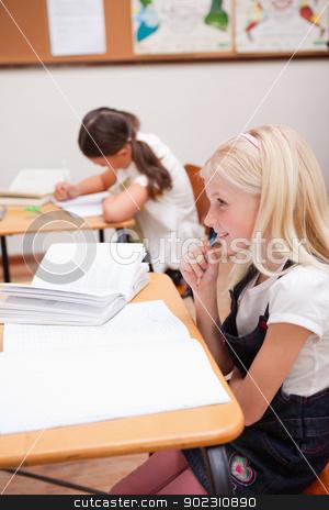 Portrait of pupils doing classwork stock photo, Portrait of pupils doing classwork in a classroom by Wavebreak Media