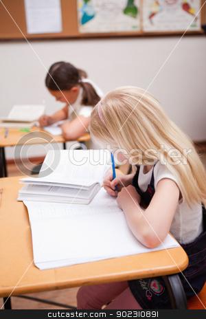 Portrait of pupils working stock photo, Portrait of pupils working in a classroom by Wavebreak Media