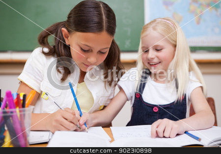 Pupils working together stock photo, Pupils working together in a classroom by Wavebreak Media