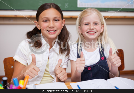 Portrait of happy pupils working together with the thumbs up stock photo, Portrait of happy pupils working together with the thumbs up in a classroom by Wavebreak Media